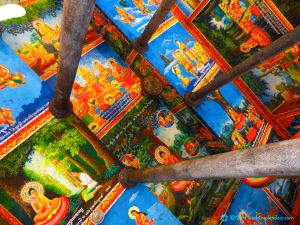 Vividly painted interior of monastery temple at Siem Reap, Cambodia